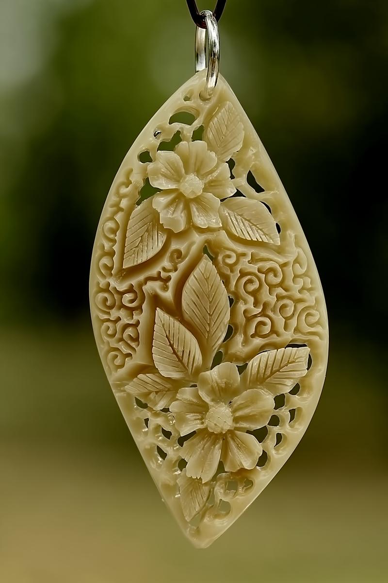 pendant 2 - bone carving by manuroartis