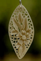 pendant 8 - bone carving by manuroartis
