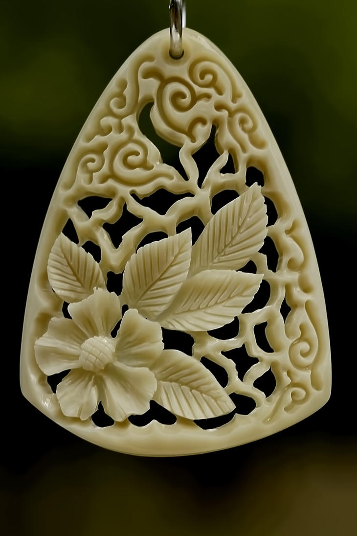 pendant 9 - bone carving by manuroartis