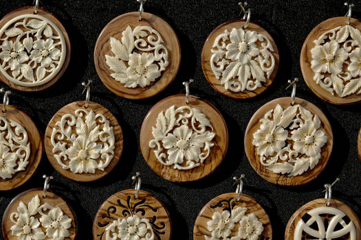 bone medallions on olive tree wood  - detail 3