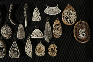 vegetable ivory with olive wood pendants 1