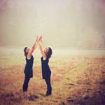 hands held high by Lisa-Schneider