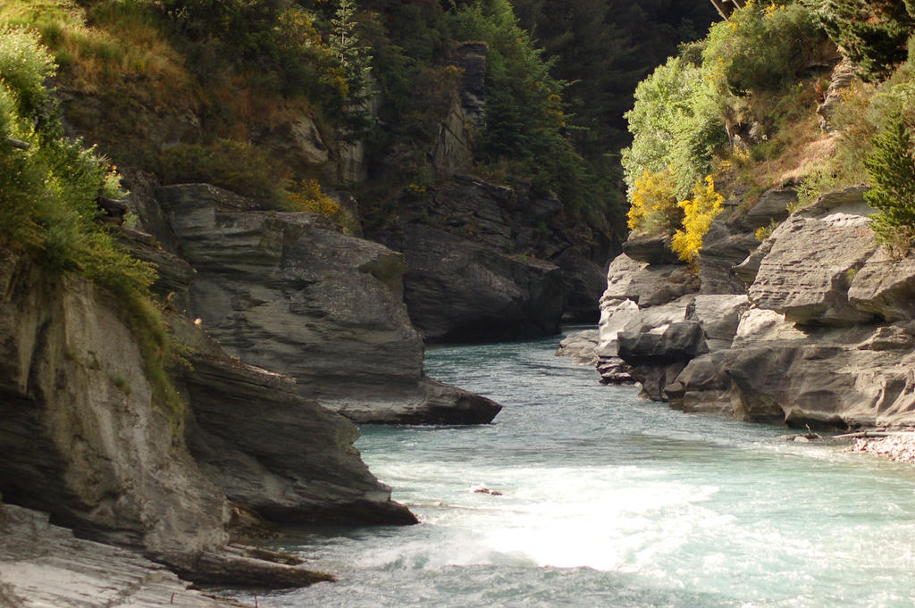 NZ Winding river, soft sunlight, rock edges by Chunga-Stock