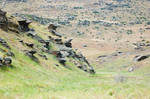 NZ Empty riverbed grass valley rocky sides