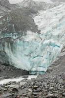 NZ Rocks leading to snow glacier by Chunga-Stock
