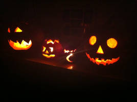Row of halloween pumpkins with candles 0295 by caspercrafts
