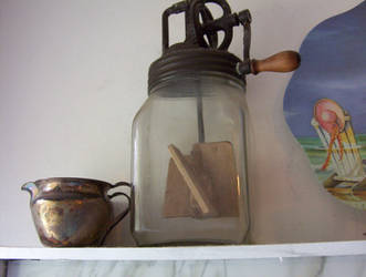 Glass butter churn and silver cream pitcher by caspercrafts