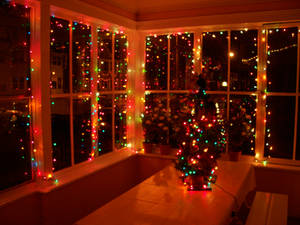 Red holiday lights on glass windows