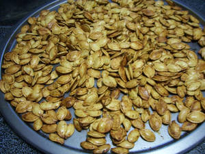 Tray of baked pumpkin seeds