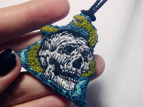 Skull n snake necklace