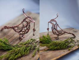 Bird with garnet key by UrsulaJewelry