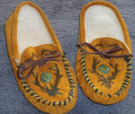Redecorated leather moccasins