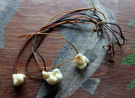 Black Bear Bone Necklaces by lupagreenwolf