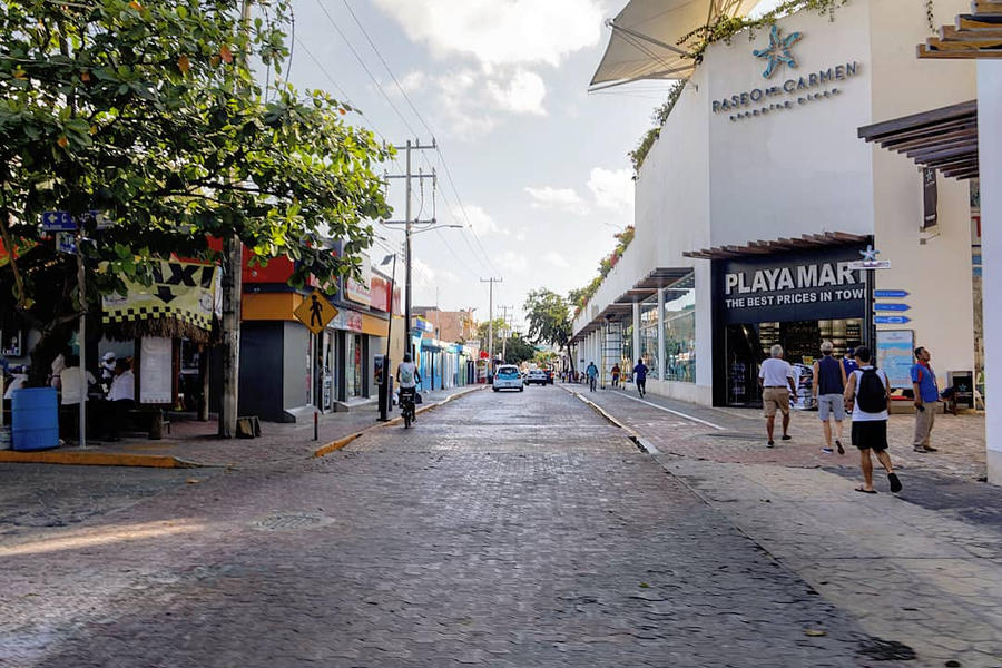 Walking through the streets of Playa Del Carmen by sequential