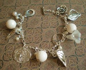 silver charms bracelet by meganhor