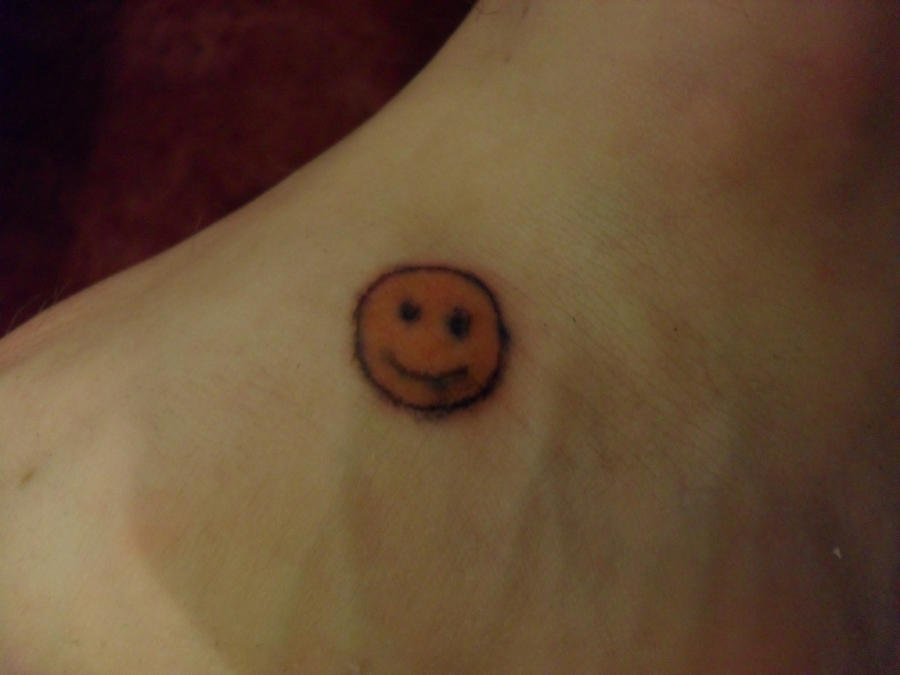 smiley tattoo by moowie23 on