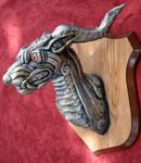 Silver creature head