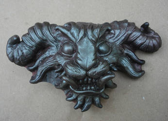 Demon head buckle