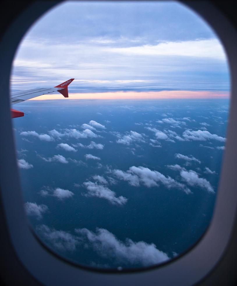 through an airplane window by freye on DeviantArt