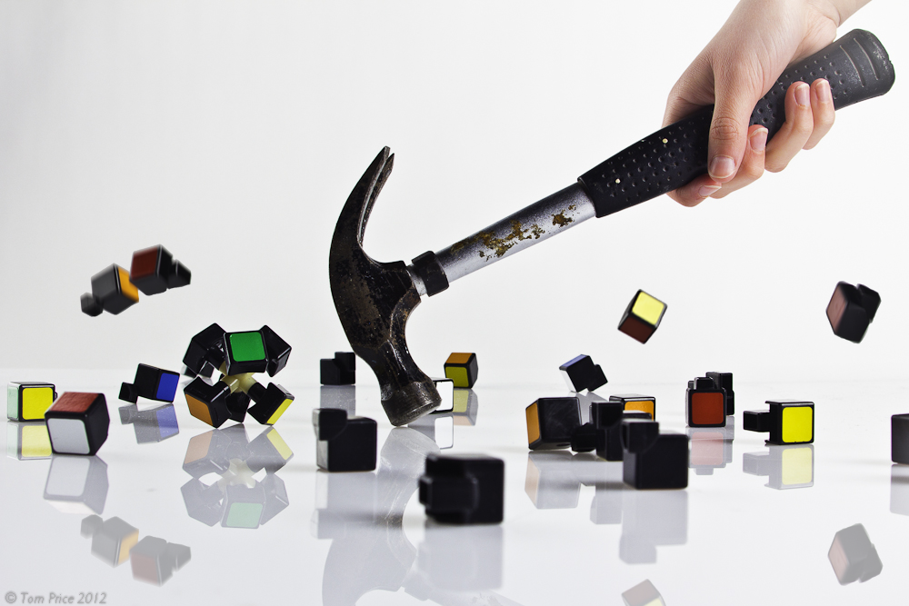[Image: smashed_rubik__s_cube_by_thomassedgewick-d4ms1wx.png]