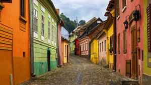 A colourful street in Sighisoara, Romania.
