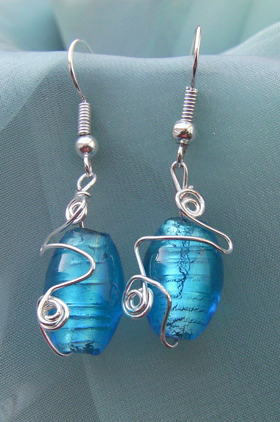 Wire Wrapped Blue Foil Bead Earrings 2 by cunningcatcrafts on DeviantArt