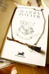 Miniature Firebolt necklace by sixAstray
