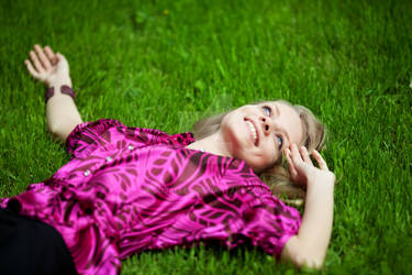 happy girl on green field