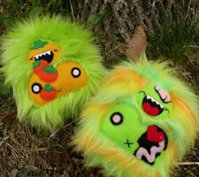 Pumpkin Yeti and Zombie Yeti by loveandasandwich