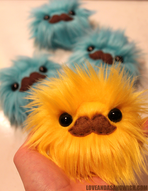 Yellow Mustache Monster by loveandasandwich
