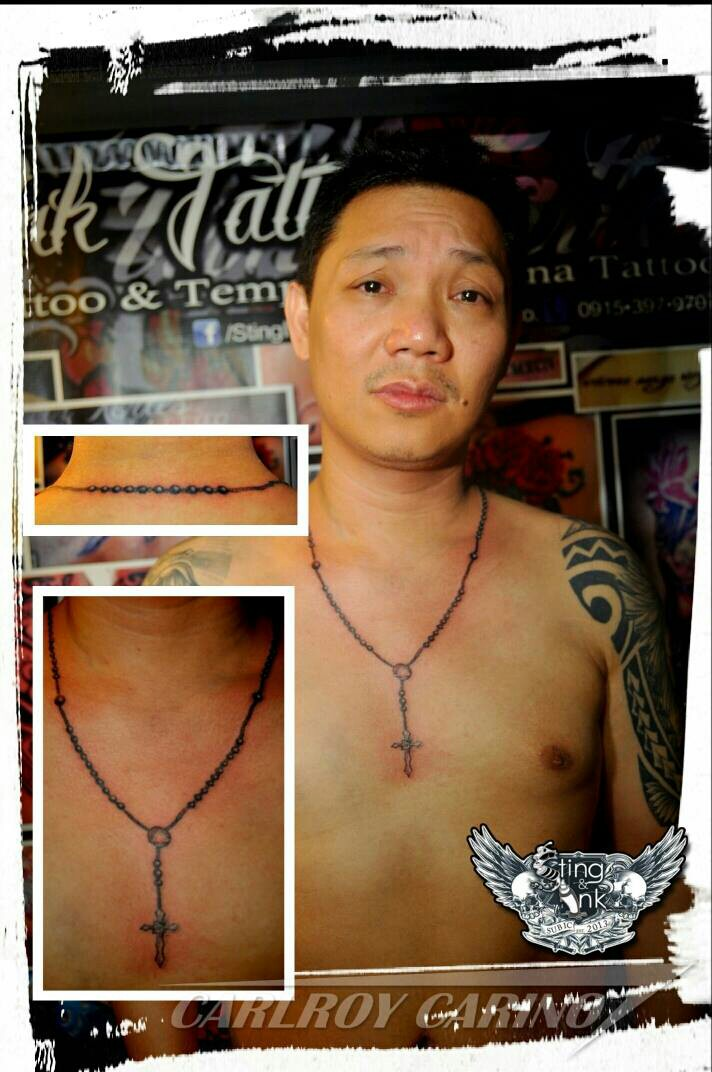 Rosary tattoo by carlroycarino