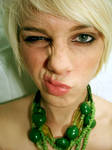 Green necklace.