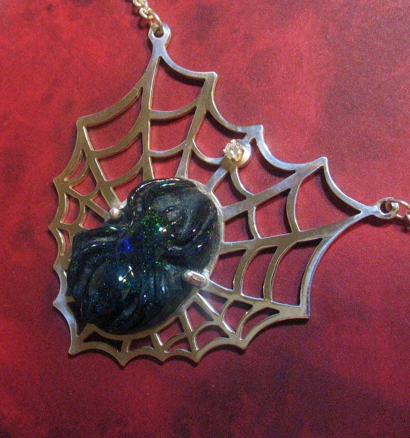 Carved spider opal pendent
