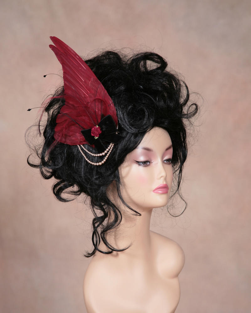 Hand dyed pigeon wing fascinator by Genevieve-Amelia