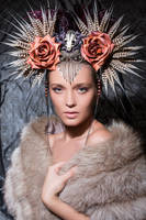 Pheasant feather and silk cocoon headpiece by Genevieve-Amelia