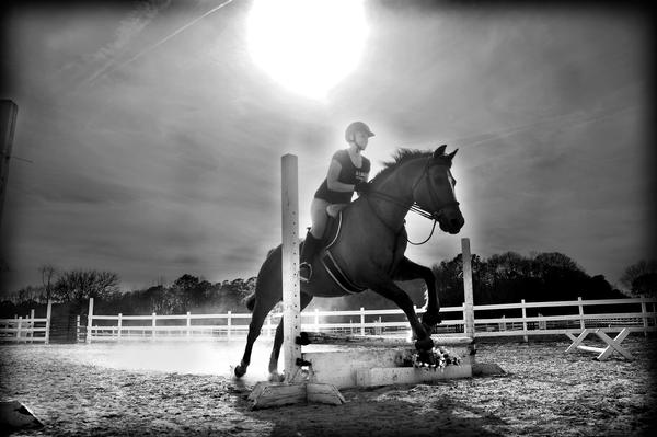 A girl on her horse jumping by speedycrabinc