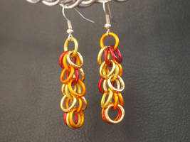Fire Nation Dangle Ring Earrings by Streetmail