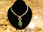 solid gold pendant with ammolite
