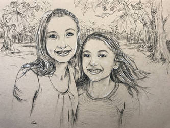 Portrait of two sisters in charcoal on toned paper