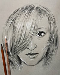 Portrait in charcoal pencil on toned paper