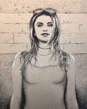 Portrait against wall in charcoal pencil