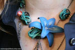 Steampunk lily necklace by Animus-Panthera
