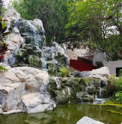 Fish pond and Waterfall by littleangellaura1