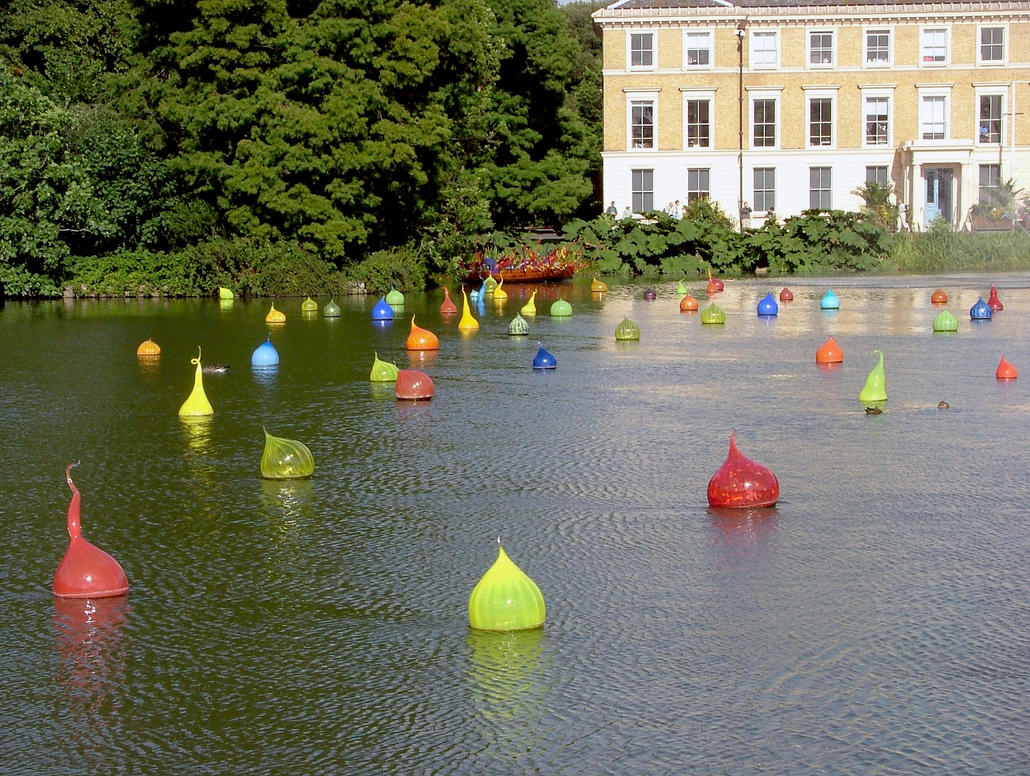 Chihuli Glass Floats On The Palm House Lake At Kew by aegiandyad