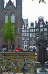 Canal Side Bronze Woman Statue In Amsterdam