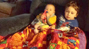 Logan and Adam w the quilt
