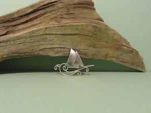 Swirling silver ship pendant