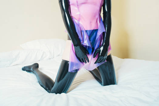 Latex dress on the bed #2