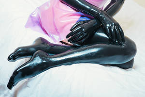 Latex dress on the bed #3