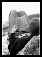 Reading on a Log by malchikwik